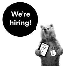 "Bear holding a mug and a tablet open to CLIO with a bubble above her that says ""we're hiring."""