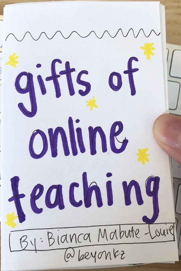 photo of the zine Gifts of Online Teaching, and the creator's thumb holding the zine