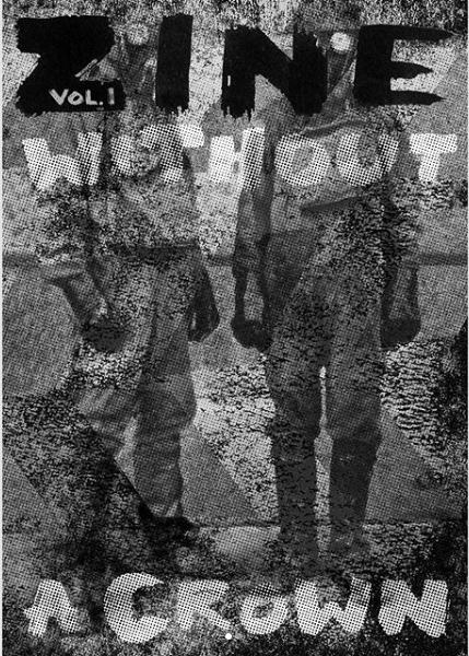 zine cover: grainy/dirty lens photo of soldiers (?) with handwritten, all-caps title obscuring their faces