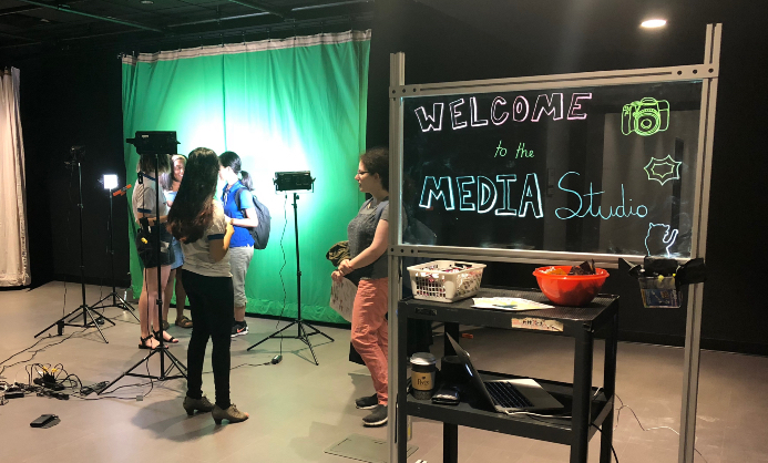 "Sceen saying ""Welcome to the Media Center"" with green screen in background"
