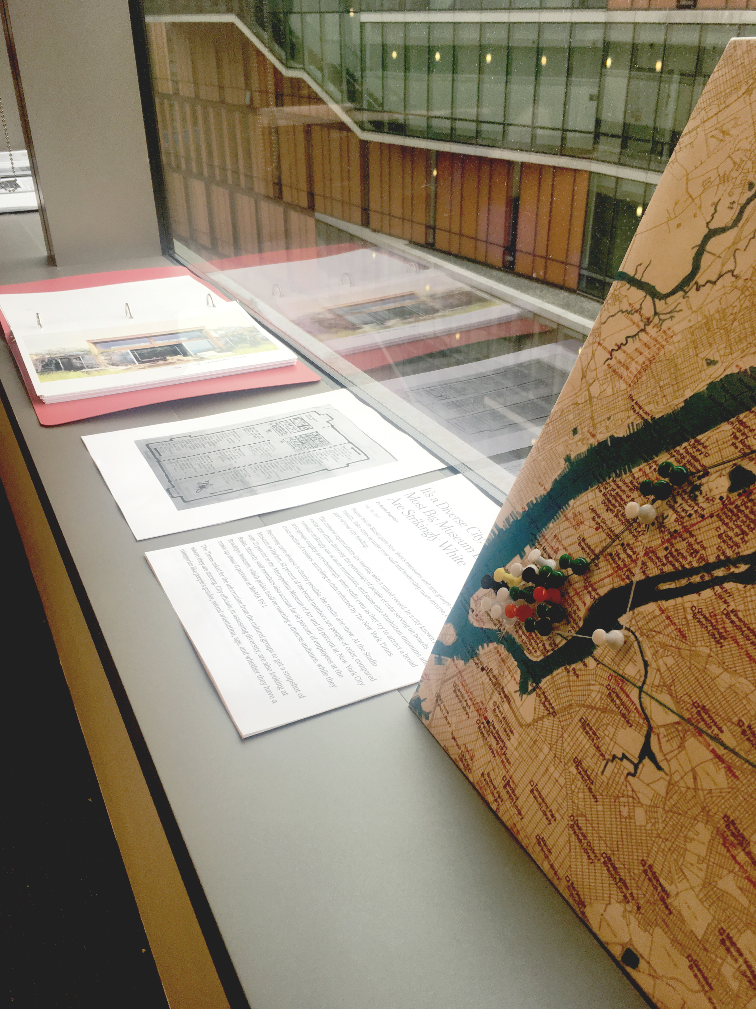 Materials from Professor Siddiqi's class are laid out on a window sill, available for the exhibit's visitors to peruse.