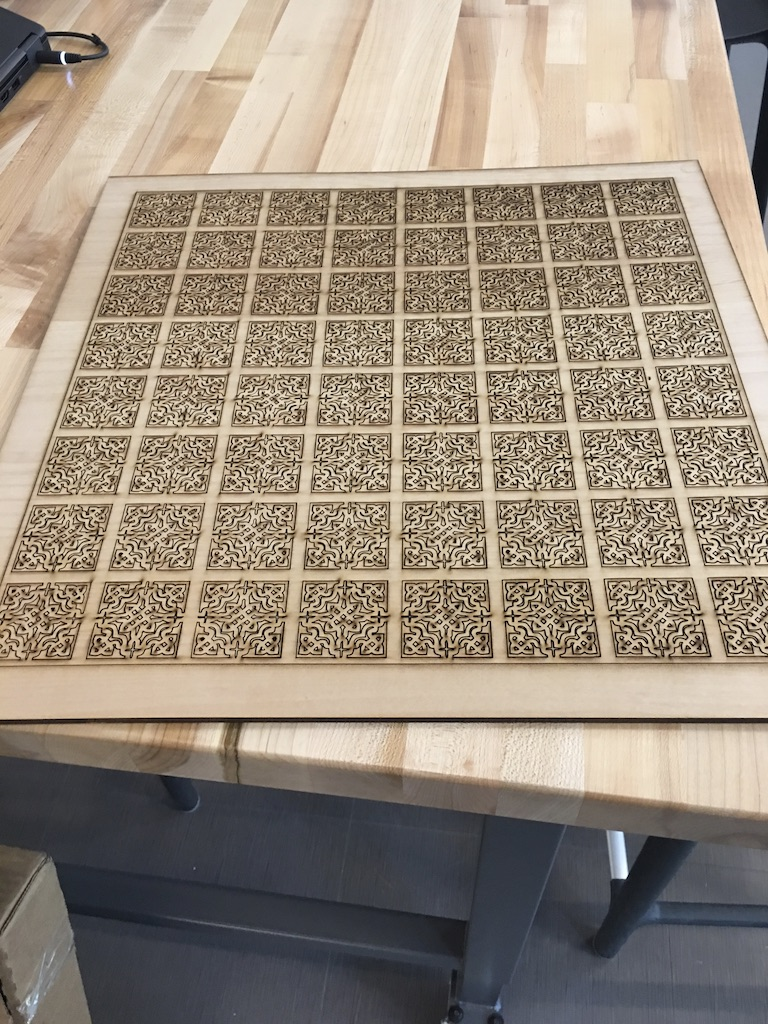 The chess board, after laser cutting is completed, but before color is painted on.