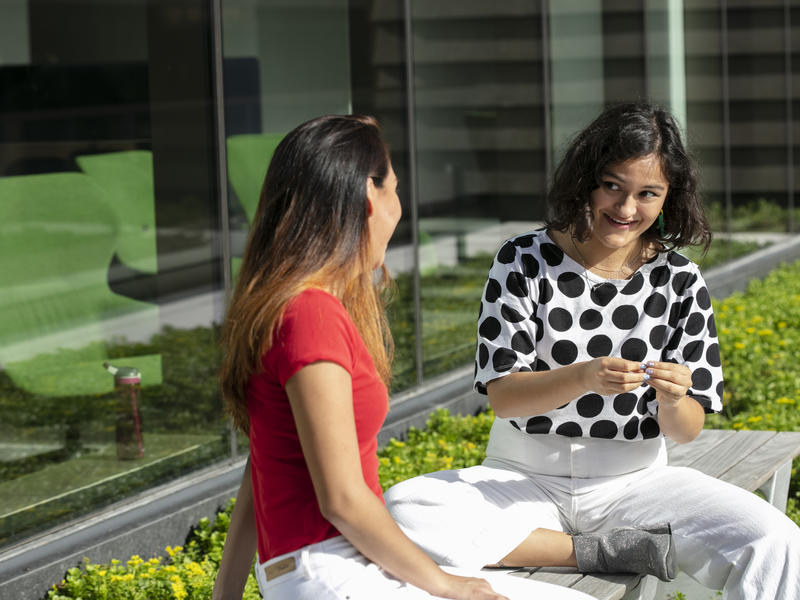 Two students relaxing on a terrace